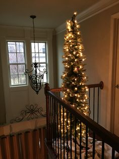 Secondary green Christmas tree top stairs