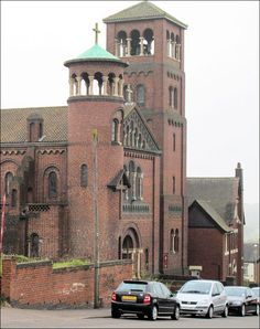 Roman Catholic Church of St. Joseph, Hall Street, Burslem - The two west towers; one square in plan and one smaller and round.