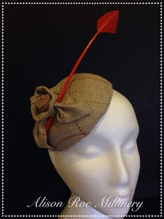 Plaid cocktail hat with arrow head quill