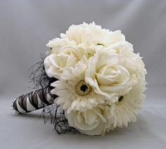 I can make this: fake flowers, black and white ribbon, feathers, and pearl straight pins!