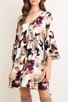 5fc51f15284a3 This Floral Babydoll Dress w/front button up detail & bell sleeves in berry  is a gorgeous floral print dress to wear for any occasion!