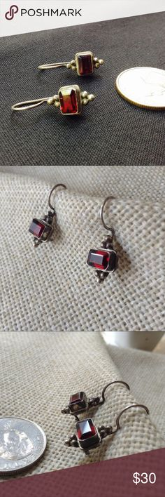 """Vintage Sterling Silver & Garnet Earrings Vintage sterling silver, dangle earrings with deep wine red garnets. Garnets are 1/4"""" wide set in a deep bezel with """"grape"""" ornamentation in silver beading on top and bottom. Stamped 925. Lots of patina which looks great with these but if you prefer a polished shiny look, that is totally possible, however I leave that for you to decide and do. For pierced ears. From Mexico decades ago. Formal elegance. Thanks for stopping by. Vintage Jewelry Earrings"""