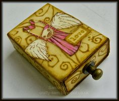 An altered matchbox using Stampotique stamps
