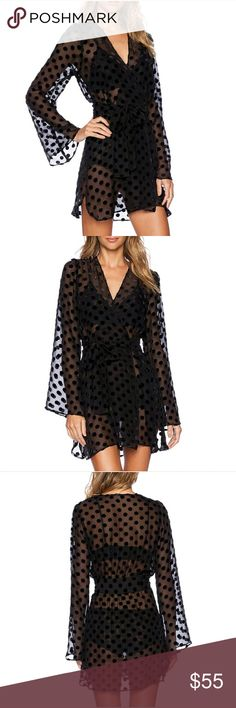 ⭐NEW! Sexy Black Chiffon Wrap Mini Dress SMALL Beautifully unique statement piece!  My personal favorite! ☄❤☄  Sexy sheer chiffon  - polka dot detail- black sash - Perfect to wear poolside at the beach or at a bbq. Wear over a bathing suit, bodysuit or wear over whatever you're in the mood for. Polyester.. High quality fabric. NWOT Directly From Vendor - Size Small - True to size   ▪ Price is Firm  ▪ No Trades  ▪ Fast Shipping Moda Ragazza  Dresses
