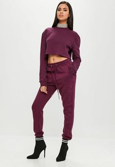 These burgundy joggers feature an elasticated waistband with drawstring, slim leg and fleeced lining.