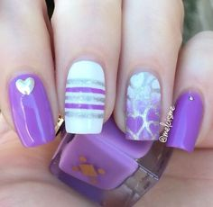 A really cute looking Purple nail art design. Using silver glitter polish to create shapes as lines and hearts on your nails, the design looks so trendy and pretty.