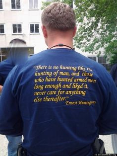 "NYPD ""hunting of man"" t-shirts seen on on-duty officers in Queens. These are criminals with badges. Anyone on the government payroll who wears a T-shirt advertising their bloodlust is to be avoided like the psychopathic PLAGUE they are."