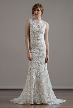 A high boat necked wedding dress from @liancarlodesign | Brides.com