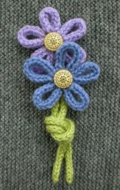 How to make flowers from knitted I-cord or French Knitting...might try Foundation Chain in Crochet.