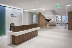 Architecture group RS Investments Office by Huntsman Architectural Group - Office Snapshots RS Investments Office by Huntsman Architectural Group - Office Snapshots Modern Reception Desk, Reception Desk Design, Reception Areas, Office Reception, Dental Office Design, Office Interior Design, Corporate Interiors, Office Interiors, Office Spaces