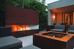 Design tip: Use fire as focus. We like how fire and water are used to balance this gathering spot.