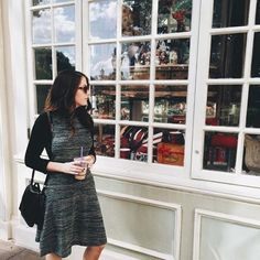 cute styling idea. Put a turtleneck or long sleeve under a dress