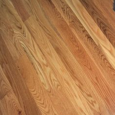 Newly installed 5 inch red oak sand on site finished with Unstained hardwood floors