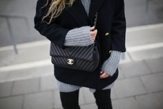 For those extra cold layers, later two sweaters. And don't forget your black Chanel.