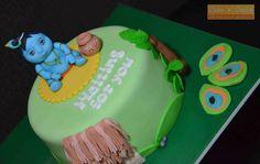 Krishna themed baby shower cake