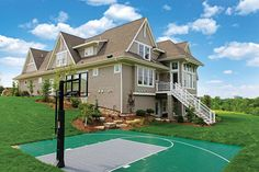 Exterior with Basketball Court by Carl M. Hansen Companies | Luxury Home Tour