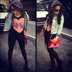 pink/blue/purple tie dye beanie - black legging/jegging/jeans - black lace up booties with red heel - light wash jean jacket - long cut up skull heart shirt with flyaways - black sunglasses - pink/red/black colorblock bag - gold watch and bracelet - gray/gold necklace