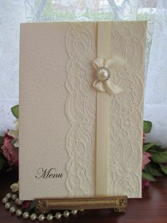 K0039 A5 Menu Ivory Lace Satin Pearl Diamante St Moritz Available from www.vintagelaceweddingcards.co.uk