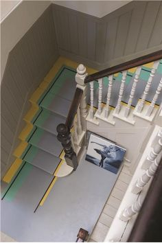 Stairs and Floor painted in Farrow & Ball's Dove Tale, Arsenic, Mahogany and Babouche Floor Paint and walls in Off-White Estate Emulsion.