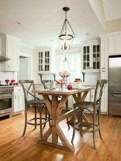 Love this rustic kitchen table at bar height. Traditional. Farmhouse. Modern twist.