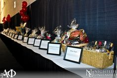 Gamma Phi Auction Table. Love the frames to display the item descriptions.