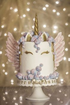 My version of the ever so popular Unicorn cake with meringue kisses and MERINGUE WINGS! White chocolate drip painted in gold luster. Cake is 4 layers of unicorn swirl and iced in buttercream. BTW- I made this cake just for fun but it sold the next...