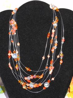 Orange Illusions Necklace by OurBeadedCharms on Etsy, $39.00