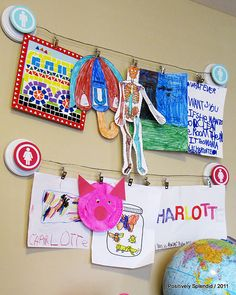 Children's art display with cable, name badge clips.  DIY