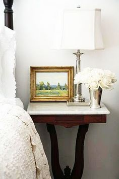 Love the marble topped walnut tables for beside the bed . . . the nickel lamp and mint julep cup filled with roses just takes the cake!