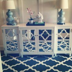 Rug color - mirrored buffet with inserts that speak to rug pattern plus those great lamps!