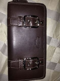 Available @ TrendTrunk.com Brown Leather Coach Wallet. By Coach. Only $48!