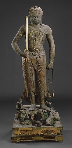 Heian Period (794-1185) One of the Five Wisdom Kings, Fudo Myo-o is filled with wrath against evil. Serving Dainichi Nyorai, he holds poised his sword and noose to contain anything that might harm a believer. Size and fearsome physical attributes, including fangs and a half-closed eye that turns inward, command respect, as does the exaggerated length of his limbs.