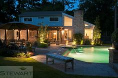 With the right lighting you may enjoy the look of your backyard more at night than you do during the day! #StewartLandDesigns