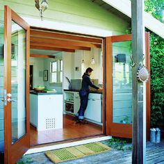 My thing for french doors, esp from a kitchen. I'd keep them open all summer long.