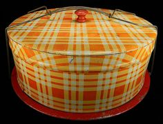 A fantastic orange plaid cake and pie carrier... metal cake carrier...