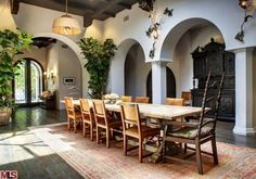 Interior arches...odd that light fixture is in the center of the space and nothing over the table.