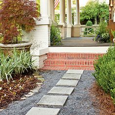 A Southern Craftsman Restoration | Tamed the Yard | SouthernLiving.com...  secondary walk to my porch... great idea.