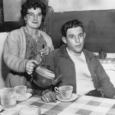 August 1963: Train driver David Whitby gets a cup of tea from his mother at home in Crewe, Cheshire