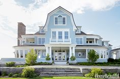 Pittsburgh Paints' Citadel Blue brightens the exterior of the Lake Michigan house, designed by Alexander Bogaerts. Interior design by Martin Horner of Soucie Horner.