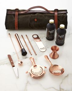 #ONLYATNM Only Here. Only Ours. Exclusively for You. Storage roll made of olive-drab twill with cotton/polyester binding and leather handle and trim. Coated copper tools. Set includes 8-oz. Owl's Brew