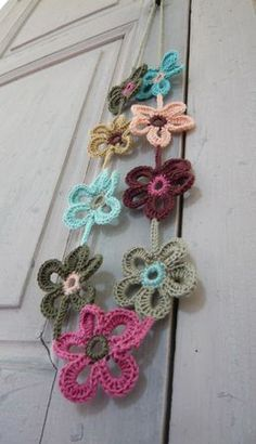 Flower necklace (picture for inspiration.) Shouldn't be too hard to find a pattern for similar flowers.