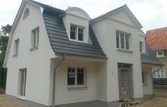 """Besichtigen Sie aus unserem umfangreichen Hausprogramm eine individuell geplante """"Mansardendach-Villa"""" auf Bodenplatte mit ca. 183m² Wohn- und Nutzfläche."""