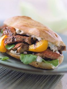 Need a break from burgers? Try these French roll sandwiches, stuffed with slices of steak, grilled sweet pepper, and a refreshing mayonnaise sauce.
