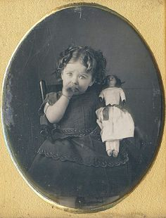 Daguerreotype of a toddler sucking her thumb & holding her favorite doll. Oh, the poor darling! Look at her eyes! She doesn't know whether to cry, or not. It's all right, sweetie, you'll be in mommy's arms in a minute. Vintage Children Photos, Vintage Pictures, Old Pictures, Vintage Images, Old Photos, Vintage Abbildungen, Vintage Girls, Vintage Prints, Victorian Photos