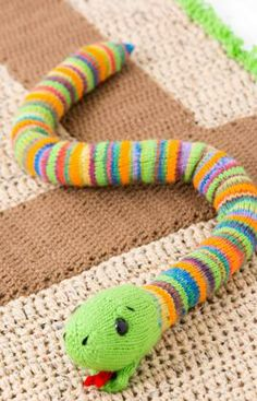 Colorful knit stripes are a sure sign that this is a playful snake. For a smoother snake skin, stuff a knee-high stocking and then insert in...