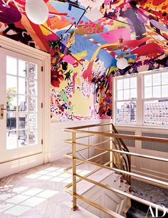 A wall covering by Assume Vivid Astro Focus animates the stairway.  ... and brings the eye right to the view...