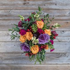 Our Harvest Bouq is fall-friendly, greeting you and the season in style. Cozy-colored flowers like purple kale, orange roses, cheery red hypericum berries and cool greenery come together to create an arrangement that will elevate any tablescape. Plus, the flowers in this bouquet are delivered from eco-friendly, sustainable farms.