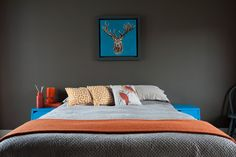Dark walls, accents in orange, Panton S chairs, Vladimir Tretchikoff art (I have the 'Chinese G...