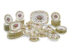 A COALPORT PORCELAIN PART DINNER SERVICE  CIRCA 1825  each piece painted in the center with a brown basket of pink roses and green leaves, comprising four circular serving dishes and covers, four circular sauce tureens, covers and stands, ten oval platters in sizes, twenty-two soup plates and fifty-three dinner plates, some pieces with impressed numeral 2 or other numerals. 105 pieces.