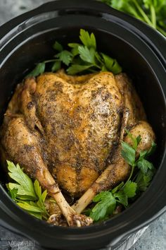 This easy Crockpot Turkey recipe is for those who don't want to be bothered with roasting! It's slathered in garlic butter and cooks all day (or night!) in the slow cooker. #slowcooker #crockpot #turkey #thanksgiving #christmas #recipe